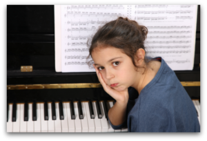 sad girl at the piano