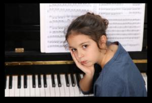 sad girl at the piano